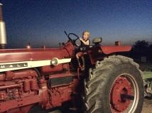 Caedmon driving a tractor.