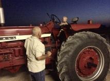 Malakai driving a tractor.