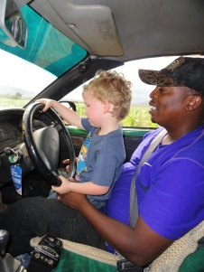 Bonface teaching Caedmon to drive at age 3. You're never too young in Africa!