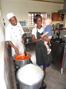 Malakai learning to cook with Uncle Zakayo and Auntie Teresea.