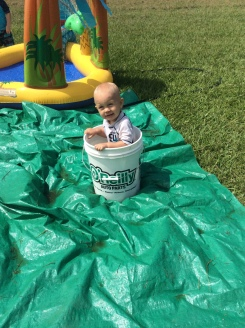 This bucket was for rinsing off our grassy feet, but that didn't bother Kai.