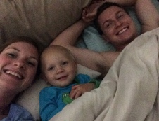 Snuggling with Mommy and Daddy.