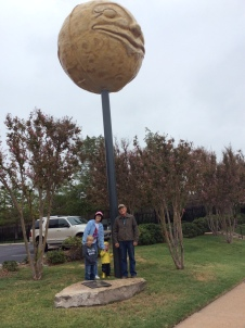 The boys and Julia's parents looking at art in downtown Abilene.